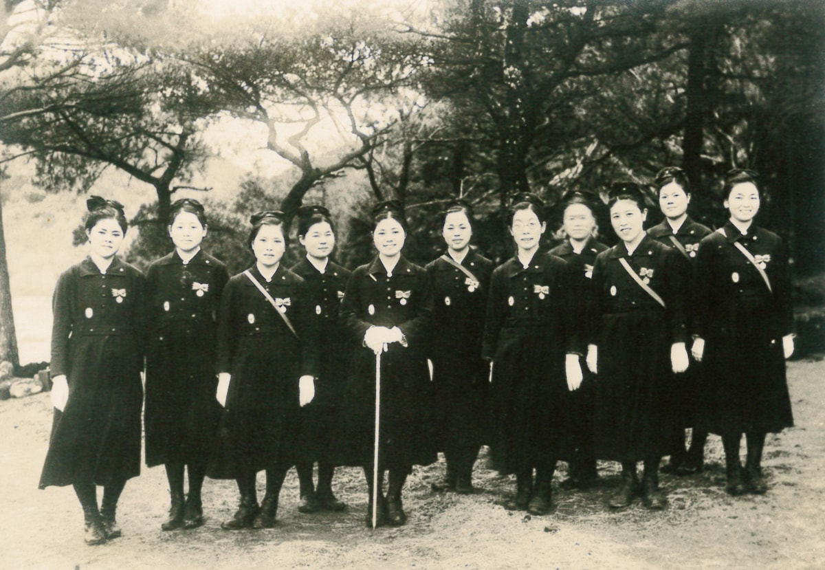 Nobu with her friends when she was enrolled in the Japanese Red Cross Society's Relief Nurse Training School (second from right)