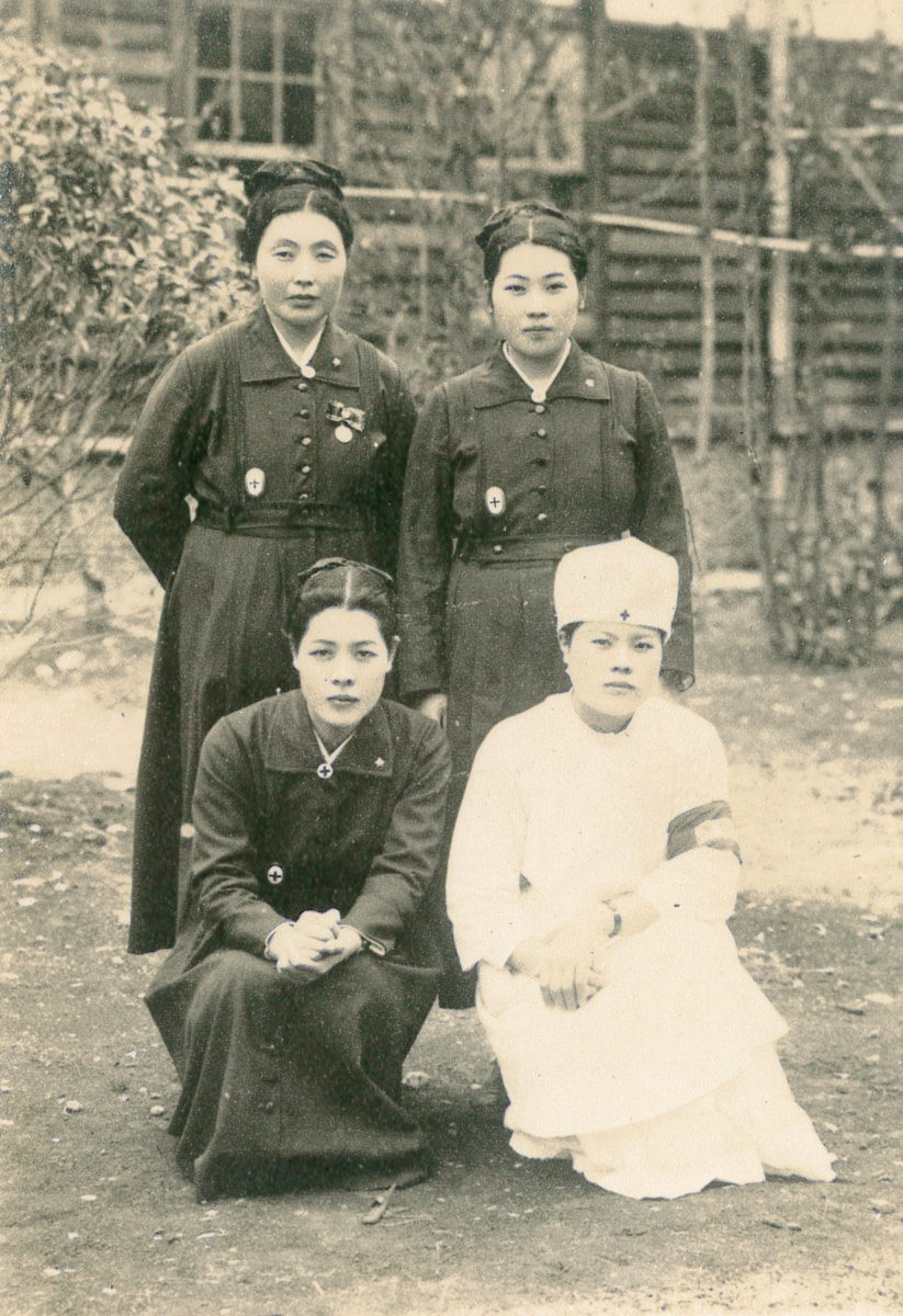 Nobu with her friends when she was working at Kokura Military Hospital (bottom right)